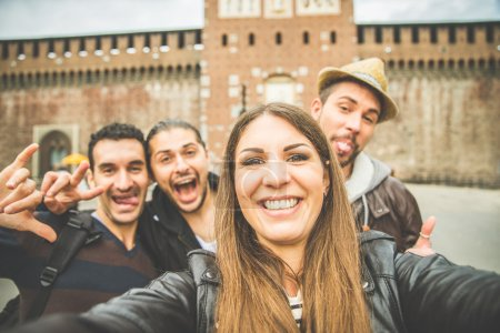Photo for Group of friends taking a selfie - Tourists taking a photograph at Sforza Castle in Milan,Italy - Royalty Free Image