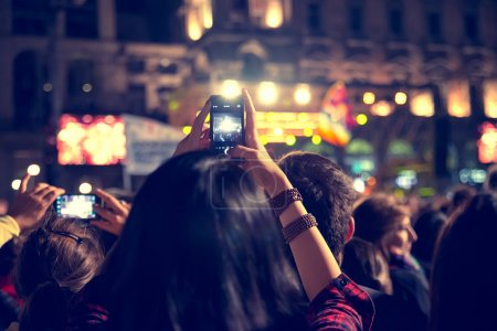 Photo for Supporters recording at concert - Candid image of crowd at rock concert - Royalty Free Image