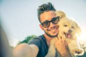 Young man and his dog taking a selfie