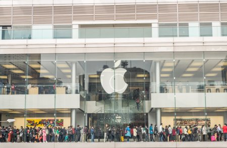 Photo for HONG KONG - FEBRUARY 13,2015: crowded Apple store in Hong Kong. Apple's flagship stores in China are packed with people who often line up to grab on one of the company's latest gadgets - Royalty Free Image
