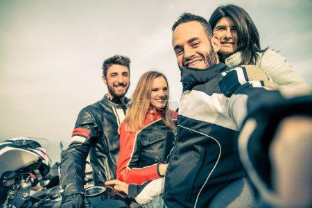 Group of bikers taking selfie
