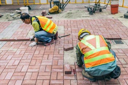 Bricklayers at work