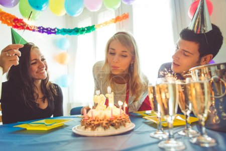 Photo for Birthday party at home. three friends celebrating the girl birthday with surprise party at home. concept about birthday, party and people - Royalty Free Image