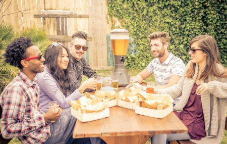 Photo for Group of friends having brunch together. sitting in the garden and drinking beer. Burgers and friets are on the table. concept about friendship - Royalty Free Image