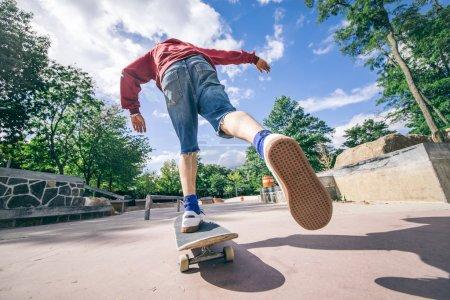 Skateboarder riding his board