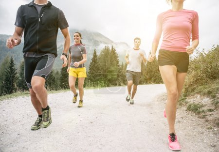 Photo for Four friends running off road on the mountains. concept about sport, friendship and nature - Royalty Free Image