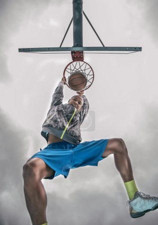 Basketball player doing a Slam dunk