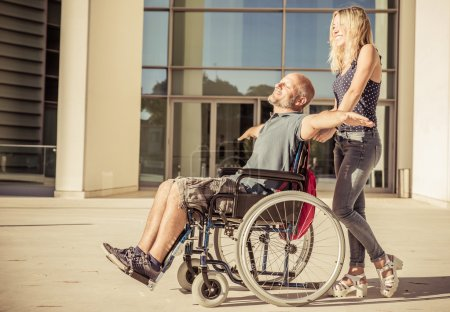 Woman and her boyfriend on the wheelchair