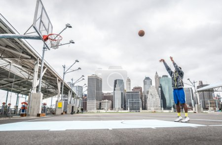 Basketball player training shots on the court