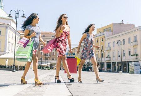 Three girls making shopping