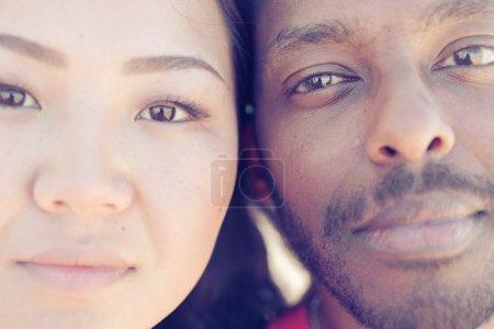 Asian girl and black man portrait