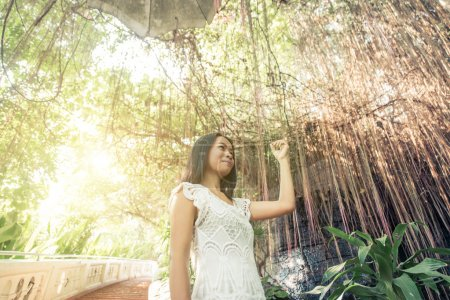 Beautiful thai girl posing in a temple. concept ab...