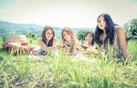Group of girls making picnic outdoor