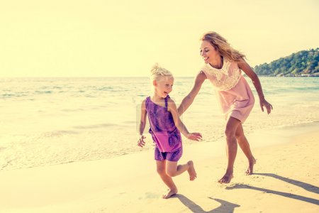 Mom and daughter on the beach