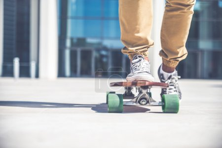 Skateboarder riding on his board