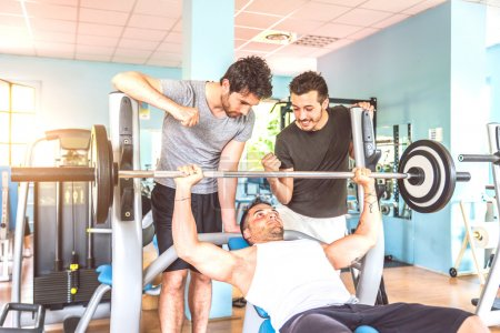 Friends training in a gym