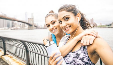 Two sport friends taking selfie after running in New york city