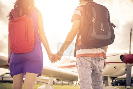 Couple getting an ariplane and leaving for an excursion