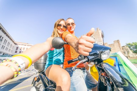Couple on scooter taking a selfie