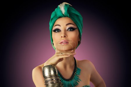 Beautiful woman in oriental style in turban...