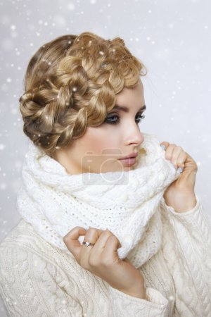 portrait of a beautiful young blonde woman on a light background.