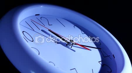 Close up of a watch on black background