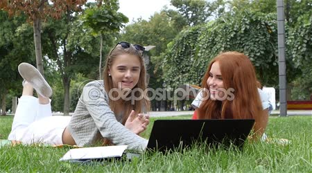 Happy girl of students on grass, studing. slow motion