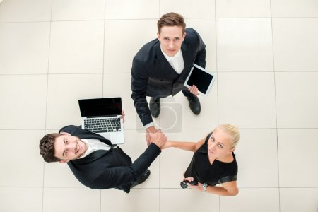 Business team. Top view of three business people in formal wear