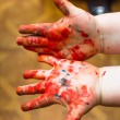 Hands stained with clay and paint. Hands painter a...