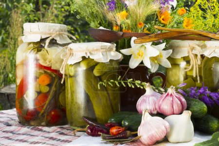 Banks with pickled vegetables - cucumbers, tomatoes, zucchini