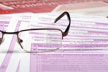 Vat tax - documents Polish with glasses...