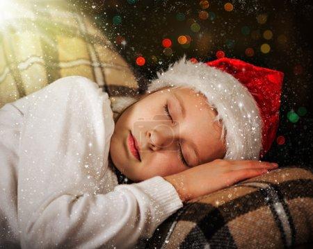 The child sleeps in christmas, christmas magic night