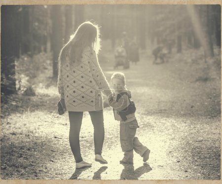 Photo for Family together playing in park mother with child black and white vintage - Royalty Free Image