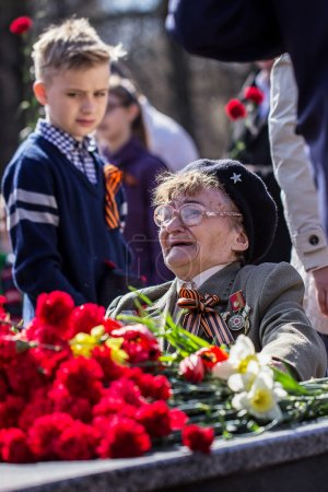 Laying flowers at the Eternal Flame. Victory Day.  Izhevsk, May