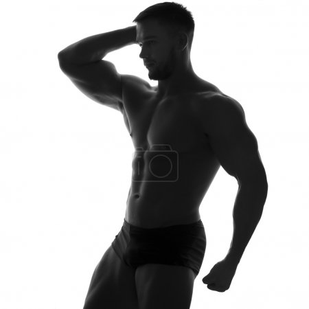 Sexy slim fit man body. Muscled abdomen. Sportswear. Isolated on