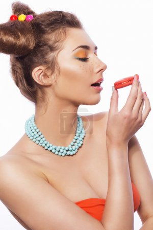 Beautiful brunette sweet woman with colorful make up and nail po