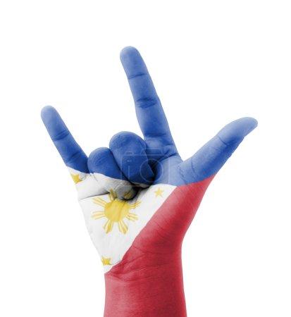 Photo pour Main faisant je t'aime signe, drapeau des Philippines peint, concept multi-usage - isolé sur le fond blanc - image libre de droit