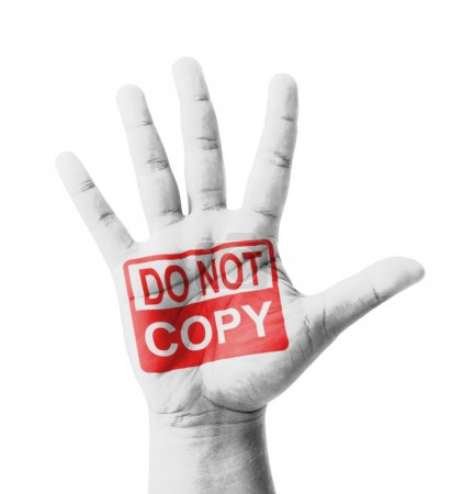 Photo pour Open hand raised, Do Not Copy sign painted, multi purpose concept - isolated on white background - image libre de droit