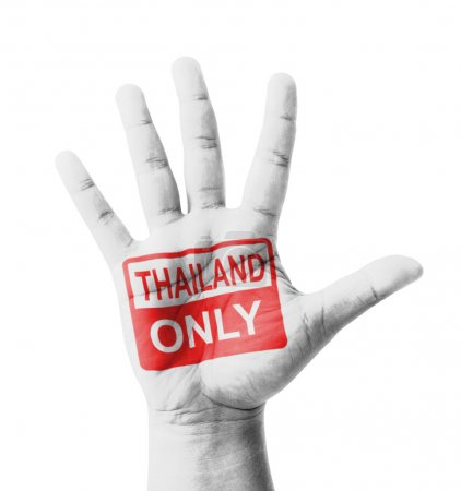 Photo pour Open hand raised, Thailand Only sign painted, multi purpose concept - isolated on white background - image libre de droit