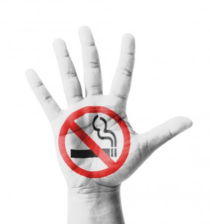 Photo pour Open hand raised, No Smoking sign painted, multi purpose concept - isolated on white background - image libre de droit