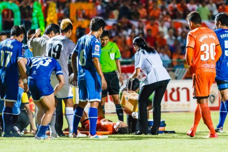 SISAKET THAILAND-AUGUST 13: First aid team of Sisaket FC. (white
