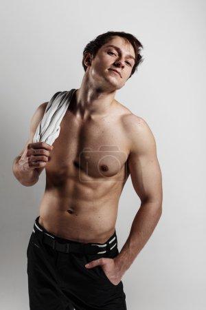 Muscular male model bodybuilder before training. Studio shot on