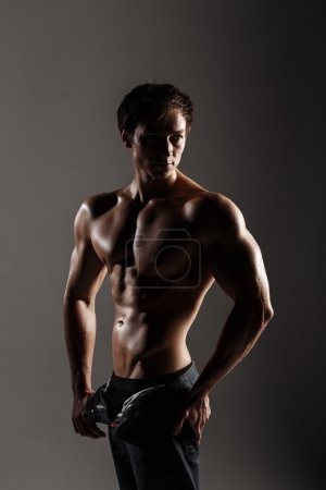 Muscular male model bodybuilder before training. Studio shot on