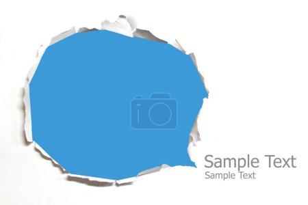 Photo pour Papier déchiré avec fond bleu - image libre de droit