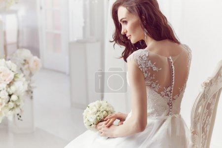 Photo for The beautiful woman posing in a wedding dress - Royalty Free Image