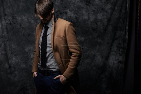 Photo for Young handsome man in a coat - studio male portrait - Royalty Free Image