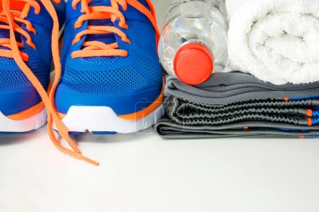 Photo for Fitness accessories with running shoes, sport clothing, drinking water and towel - Royalty Free Image