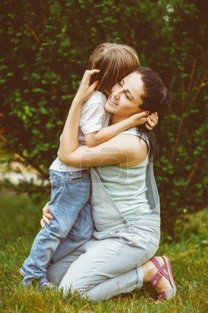 Loving mother hugging her son