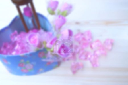 pink plastic rose with shabby chic textured blure background