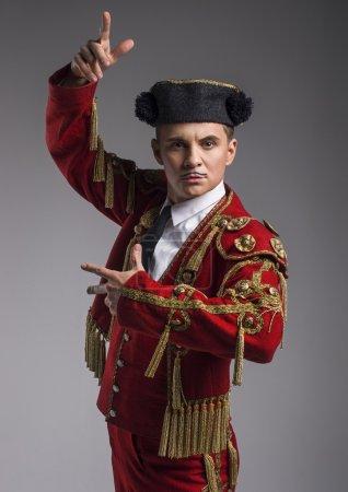 Studio shot of man dressed as Spanish matador
